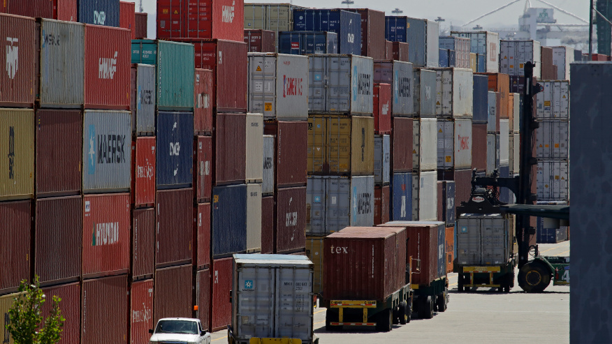 """FILE - In this July 22, 2019, file stacked containers wait to be loaded on to trucks at the Port of Oakland in Oakland, Calif. China's government says trade negotiators are in """"close communication"""" with Washington ahead of a weekend deadline for a U.S. tariff hike. But a Ministry of Commerce spokesman gave no indication of possible progress in trade talks or whether Washington might postpone the increase. (AP Photo/Ben Margot, File)"""